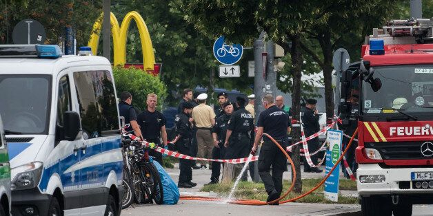 MUNICH, GERMANY - JULY 23: Police and fire services clean the area the shooting occured outside the OEZ...
