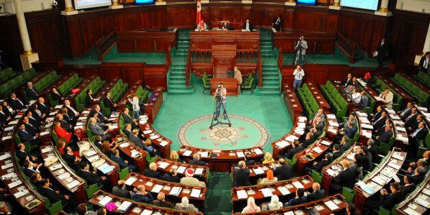 Tunisian parliament members gather during the inaugural session of the newly elected Tunisian parliament...