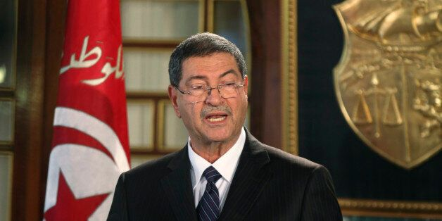 Tunisia's nominated prime minister Habib Essid speaks during his news conference, following a meeting...