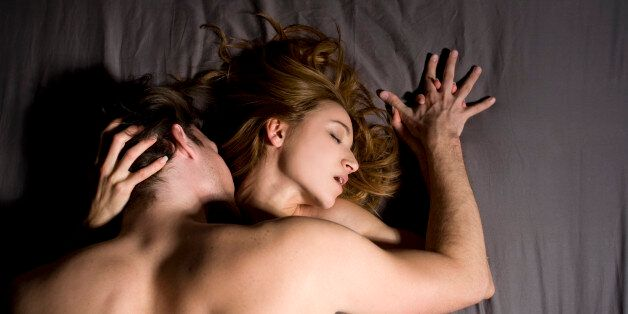 Couple engaged in sexual intercourse on