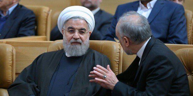 Le président Hassan Rouhani et le chef de l'Organisatin iranienne de l'énergie atomique, Ali Akbar Salehi,...