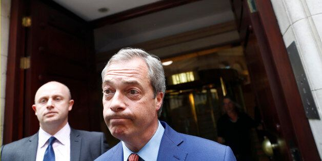 Nigel Farage, the leader of the United Kingdom Independence Party (UKIP) reacts as he leaves following...