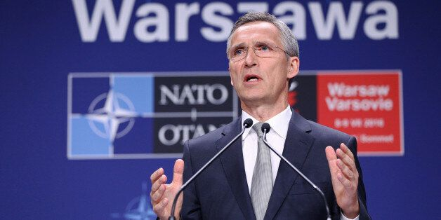 NATO Secretary General Jens Stoltenberg speaks at a news conference during the NATO Summit in Warsaw,...