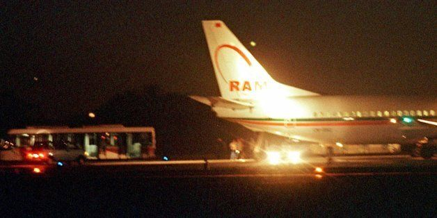Passengers are seen disembarking from a Royal Air Maroc Boeing 737 early Thursday morning Aug. 26, 1999,...