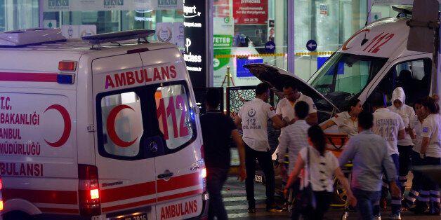 Ambulance cars arrive at Turkey's largest airport, Istanbul Ataturk, Turkey, following a blast June 28,...
