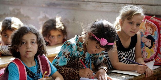 Girls attend a class at a school in southern countryside of Idlib, Syria, September 20, 2015. REUTERS/Khalil
