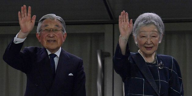 TOKYO, JAPAN - JUNE 25: Emperor Akihito and Empress Michiko wave to audience during the international...