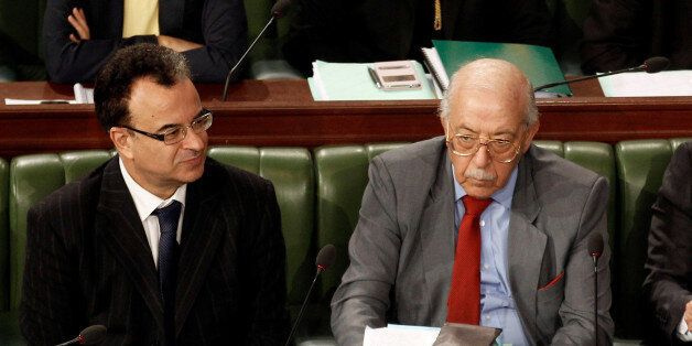 Tunisia's Finance Minister Slim Chaker and central bank governor Chadli Ayari attend a plenary session...