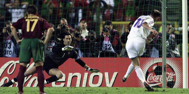 France's Zinedine Zidane (R) scores his extra time golden penalty goal against Portugal's goal keeper...