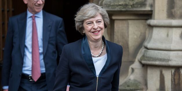 Britain's new Conservative Party leader Theresa May (R) with her husband Philip John May (L), comes out...