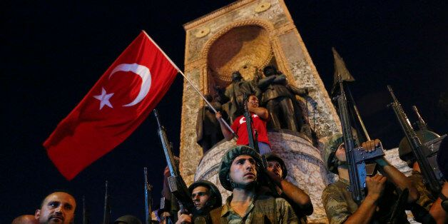 People demonstrate in front of the Republic Monument at the Taksim Square in Istanbul, Turkey, July 16,...