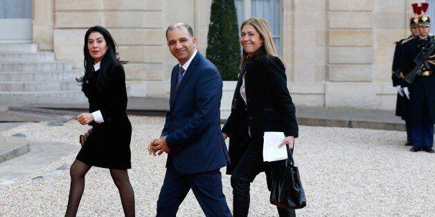 Tunisia's ambassador to France, Mohamed Ali Chihi (C) and President of France Medias Monde (FMM) Marie-Christine...