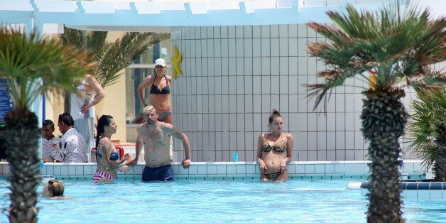 Tourists are seen inside a swimming pool at a hotel in Hammamet, Tunisia, May 27, 2016. REUTERS/Zoubeir