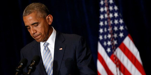 U.S. President Barack Obama pauses during remarks on recent police-involved shootings in Louisiana and...