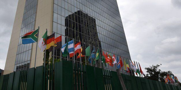 Flags fly on the provisional headquarters of the African Development Bank on September 8, 2014 in Abidjan...