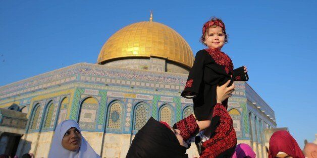 JERUSALEM - JULY 06 : Muslims gather to perform Eid al-Fitr prayer during the Eid al-Fitr holiday at...