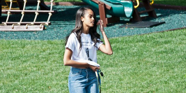 WASHINGTON, DC - MARCH 28: Malia Obama, President Barack Obama and First Lady Michelle Obama's oldest...