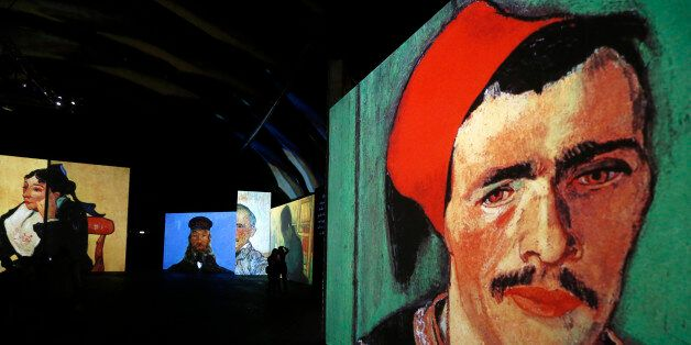 People visit the Van Gogh Alive exhibition in St. Petersburg, September 11, 2014. More than 3,000 images...