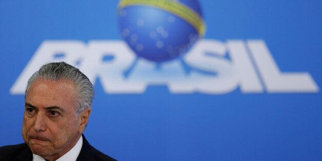 Brazil's interim President Michel Temer reacts during a statement to the media at the Planalto Palace...