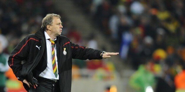 Ghana's coach Milovan Rajevac gives instructions to his players during the 2010 World Cup quarter-final...