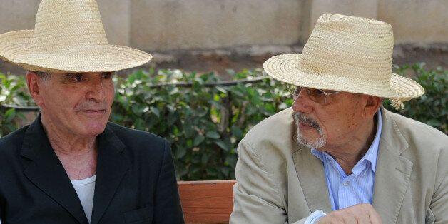 Former Algerian defence minister Khaled Nezzar (R) speaks with retired Major General Mohamed Touati at...