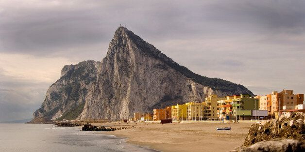 The 'Rock' of Gibraltar and La Linea, Spain as seen from the coast of Southern Spain. View related images...