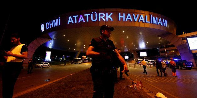 A riot police officer stands guard at the entrance of the Ataturk airport in Istanbul, Turkey, following...