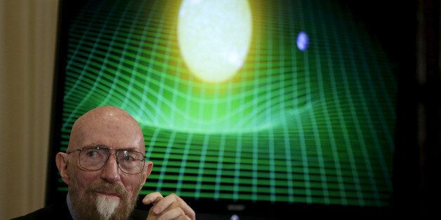 Dr. Kip Thorne of Caltech (R) listens during a news conference to discuss the detection of gravitational...