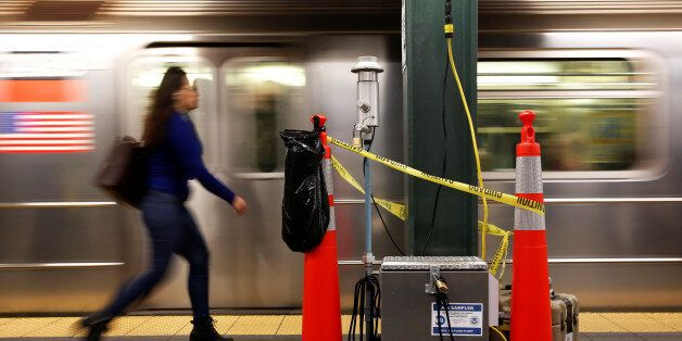 A woman walks by a device used for chemical tracers used by the Department of Homeland Security and New...