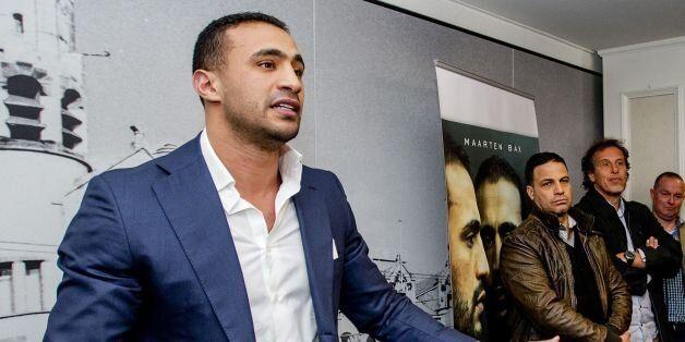 Moroccan-born kickboxer Badr Hari (L) speaks to reporters during the presentation of the book 'Badr Hari...