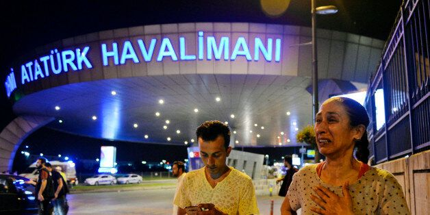 People gather on the entrance to Istanbul's Ataturk airport, early Wednesday, June 29, 2016. Suspected...