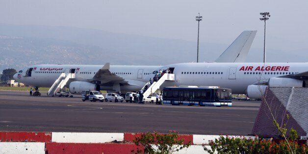 Passengers board an Air Algerie plane at the Houari-Boumediene International Airport in Algiers on July...