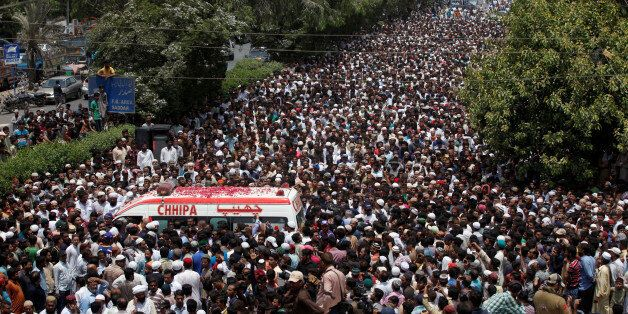 Thousands of people attend the funeral procession of Amjad Sabri, killed when unidentified gunmen open...