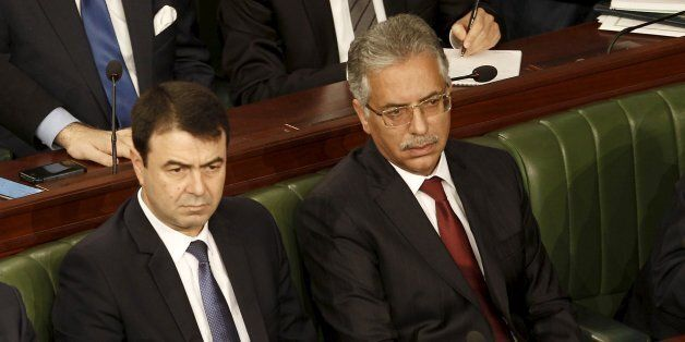 Tunisian's newly-appointed Tunisian Foreign Minister Khemaies Jhinaoui (L), Justice Minister Amor Mansour...