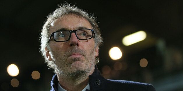 Paris Saint Germain's head coach Laurent Blanc reacts at the start of his French League One soccer match...
