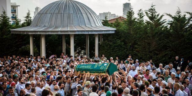 People carry the coffin of suicide attack victim Mohammad Eymen Demirci on June 29, 2016 in Istanbul...