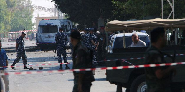Lebanese security forces secure the site of multiple suicide bombings which took place early on June...