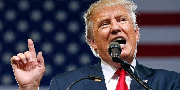 Republican presidential candidate Donald Trump speaks at a rally Saturday, June 18, 2016, in Phoenix....
