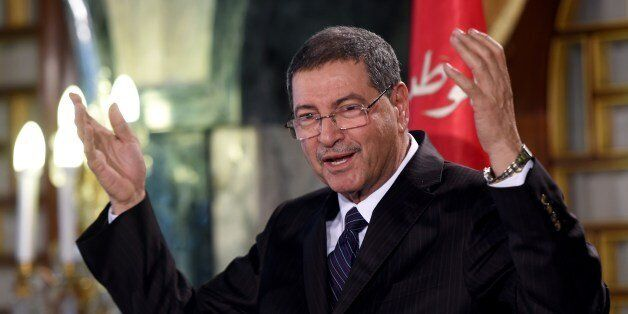 Tunisia's nominated Prime Minister Habib Essid announces a new cabinet ministers list after presenting...