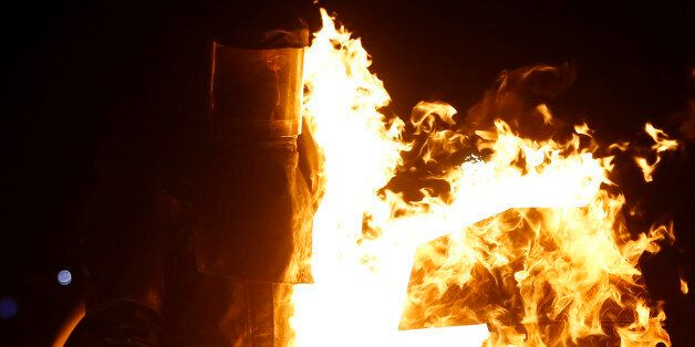 Seph, his Playa name, is hit by flames while competing on the Dance Dance Immolation installation during...