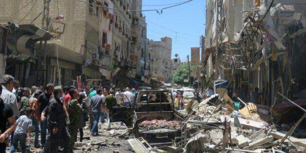Site d'une double explosion à l'extérieur du mausolée chiite de Sayead Zeinab, près de Damas, le 11 juin