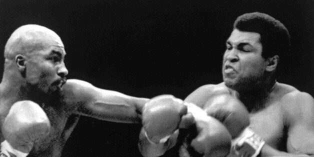 Image shows American boxer Muhammad Ali, right, and his opponent, American boxer Earnie Shavers, during...