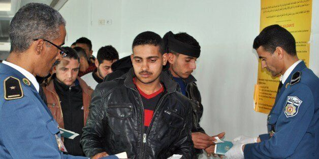 Egyptians, who were formerly residing in Libya, have their documents checked by Tunisian customs at Djerba...