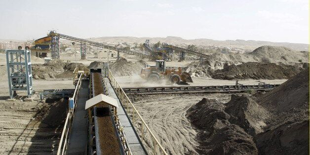 A bulldozer works at a phosphate mines in Metlaoui, Tunisia April 6, 2012. Phosphate production at Tunisia's...