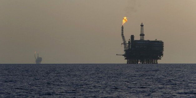 Offshore oil platforms are seen at the Bouri Oil Field off the coast of Libya August 3, 2015. Oil prices...