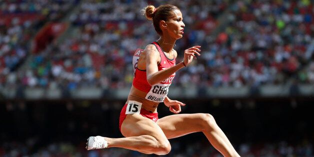 Habiba Ghribi of Tunisia competes in the women's 3,000 metres steeplechase heat during the 15th IAAF...