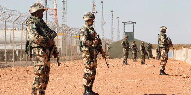Algerian soldiers are seen at the Tiguentourine Gas Plant in In Amenas, 1600 km (994 miles) southeast...
