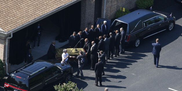 The casket bearing the remains of Muhammad Ali is loaded into a hearse at the A D Porter & Sons funeral...