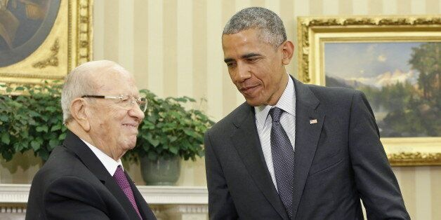 U.S. President Barack Obama (R) shakes hands with Tunisia's President Beji Caid Essebsi in the Oval Office...