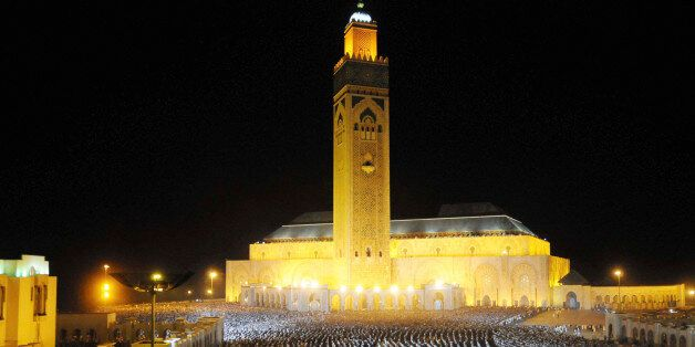Moroccan faithful pray on the esplanade of the Hassan II Mosque on Laylat al-Qadr during the holy month...